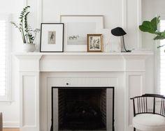 white mantel styling with layered art