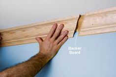"""This has a backing board which helps """"connect"""" these two pieces of wood, but to also strengthen the wood, and hopefully won't fall down"""