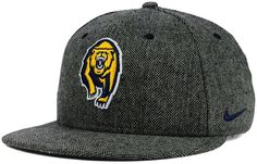 Show your California Golden Bears pride with this Nike NCAA True Tweed snapback cap. A raised logo is embroidered on this classy cap, and a Nike swoosh at the side complements the team colors while telling the world you don't settle for less than the best. High crown Structured fit Normal bill Raised embroidered team logo at front Stitched Nike swoosh logo at left side Adjustable snapback closure at back Polyester/acrylic/viscose/nylon Spot clean only