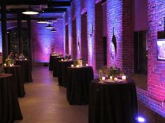 A perfect two toned uplighting on brick for your cocktail hour.  #Uplighting #wedding #weddingdj