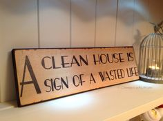A clean house is a sign of a wasted life plaque/sign www.choongysgiftsforyou.co.uk