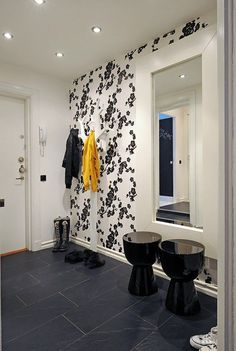 Great entryway which would've been ordinary without the wallpaper.  Take the risk!