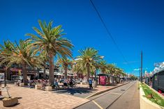 People relaxing at Moseley Square in Glenelg on a bright summer day viewed towards tram line Coast Australia, Australia Travel, Adelaide Hotels, Adelaide South Australia, Cheap Hotels, Great Barrier Reef, Luxury Travel, Best Hotels, Night Life