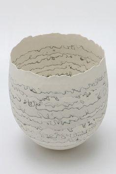 Coiled porcelain vessels with brush drawing and integrated oxides by ceramic artist Cheryl Malone.