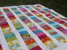 Coin quilt - I just love the variety of colours and patterns that can be incorporated into this kind of quilt.