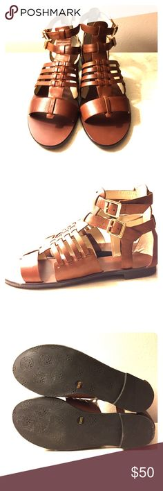 NWOT Vince Camuto gladiator sandals NWOT Vince Camuto gladiator sandals. Beautiful brown color with gold hardware. Genuine leather with rubber soles. NO LOWBALL OFFERS, please! Vince Camuto Shoes Sandals