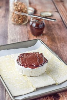 Plum jam spread on brie for the baked brie in puff pastry. There are nuts and jam in the background Baked Brie Appetizer, Appetizer Dishes, Tasty Dishes, Appetizers, Brie Puff Pastry, Puff Pastry Recipes, Plum Recipes, Plum Jam, Birthday Dinners