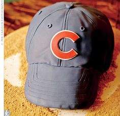 Joel's cake was shaped like a Chicago Cubs cap resting on home plate.