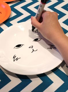 Cat-Inspired Ceramic Plate   Feeling crafty? We found this inspiring blog that shows you how to make art out of ceramic plates. It's simple to create, and the result is a feline inspired design you can use and enjoy for a long time. To make a day of it, get together with some friends and create your plates together! Materials Needed:  Ceramic Plates Colored Paper Plates Permanent Sharpies We decided to first test out some designs on colored paper plates. We also went to Pinterest to get some inspiration from all the beautiful feline designs out there. The point is to have fun and put your personality onto each plate. Finally, we took one design we all agreed on and drew it onto the ceramic plate. To make your artwork permanent, you'll need to bake it in the oven at 365F for 30 minutes. Don't forget to let it cool down after it is done. Now all that's left is to put your newly decorated plate to good use. Bon appetite! What kind of design would you create on your plate? Share with us in the comments section or on any of our social media networks, we would love to know!