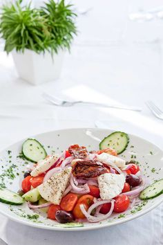 A yummy Greek Salad, with fresh ingredients from the earth of Santorini! Pyrgos Restaurant Santorini Greece