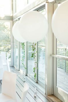 White Balloon Decor Trailing With Greenery! www.elegantwedding.ca