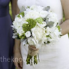 Burlap and twine were used to tie together this gorgeous green and cream bouquet filled with roses, ranunculus, lamb's ear and hydrangeas