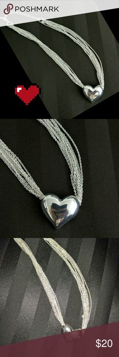 Stunning Sterling Silver Heart Necklace This necklace has fine chains and a sterling silver heart. Perfect for casual or any occasion.   Perfect condition. Jewelry Necklaces