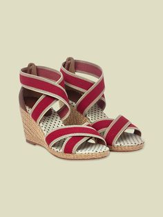 These fab crossover wedge sandals have a  cute spotty lining and elasticated straps for comfort.