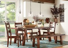 The Brick Brown Vintage Finish On This Dining Group Makes This A Beautiful Rustic Urban Option