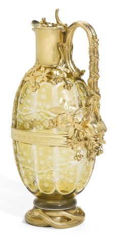 A Fabergé cut and coloured glass decanter with silver-gilt mounts, Moscow, circa 1890   lot   Sotheby's