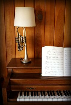 Jazz up any room with a trumpet lamp!  Yay! recycled musical instruments!
