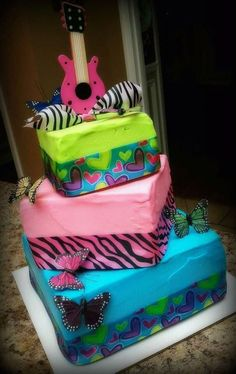 Wish this was my birthday cake!!! Love the zebra stripes!!! And the guitar at the top!
