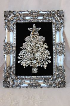 Framed Christmas tree of vintage brooches