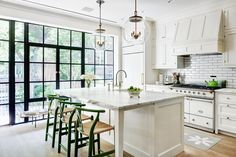 COCOCOZY: WELL DESIGNED KITCHEN - TOP 5 MUST HAVES - Great garden kitchen on Charlton Street in Greenwich village New York City townhouse apartment. Carrara marble counters, La Canche stove, green wishbone midcentury modern counter stools, Urban Electric penadant lights, wood floors and steel doors! Excellent!