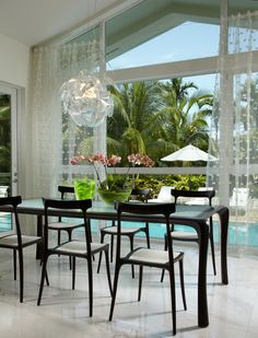 dining set with glass top table with black chairs with white seating of Simple Stylish Eloquent Contemporary Dining Set