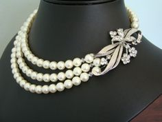 Love love love this. But I still feel like I can make this.    http://www.etsy.com/listing/87627081/pearl-bridal-necklace-flower-brooch?ref=cat3_gallery_20