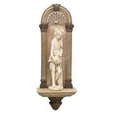 Our beautiful nymph is named for France's major waterway and hails from the exquisite Renaissance fountain in Paris' Square des Innocents. Sheltered within the stately architectural frame of a Roman arch wall niche, it beckons with graceful gesture counterbalanced by the water urn it carries.We've replicated this classic niche sculpture in designer resin to capture the intricate details, then finished it in faux stone as a perfect accompaniment to your formal space or luxury bath....