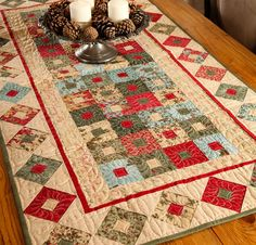 """Perfect for the holidays or anytime of year!   Create an elegant addition to your home decor with this fast and fun table runner kit from Moda and 3 Sister! Chic, contrasting blocks and a stylish Christmas carol border from Winterlude collection fabrics make this 51"""""""" x 26"""""""" runner an enchanting conversation starter at any holiday feast. Kit includes pattern and fabric.    #quilting #quilts #quiltkit #christmas #holidays #homedecor"""