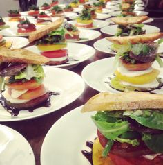 From a recent reception we catered.  Early Girl Tomato Salad Tower with Fresh Mozzarella, Baby Green Beans and Lettuces, Fresh Basil Vinaigrette and Balsamic Syrup, with an  Extra Virgin Olive Oil Crouton