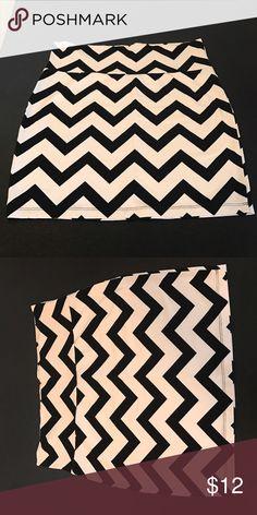 "Bodycon skirt. 17"" long black/light pink chevron print. Never worn. Charlotte Russe Skirts Mini"