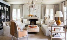 The leather chair, with its classical style, warms up this white room. 8 Designer Ideas for Beautiful Beige Rooms