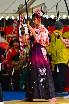 Archery in Japan. Young Women performing Kyodo at a Temple on there Coming of Age Day, 成人の日 Seijin no Hi