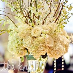 White hydrangeas and roses got a hint of sparkle from hanging crystals.