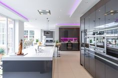 A stunning breakfast bar spans the length of the kitchen