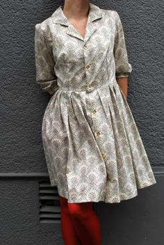 Absolutely lovely vintage print dress... paired with Red Tights.