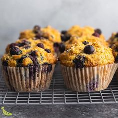 Healthy blueberry muffins are tender and soft, loaded with juicy blueberries, and have crunchy golden tops. With greek yogurt, whole wheat flour, no refined sugar and a TON of blueberries! #sweetpeasandsaffron #video