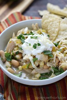 Stay warm and eat well with this healthy and delicious Slow Cooker White Chicken Chili that is loaded with flavor, but goes easy on the heat!