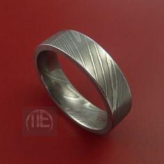 Damascus Steel Ring Wedding Band Genuine Craftsmanship Made to Any Size 3-22. $208.92, via Etsy.