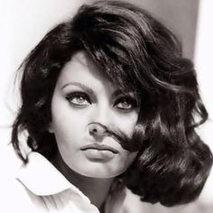 Sofia Loren. I love this hair minus the weird piece in her face.