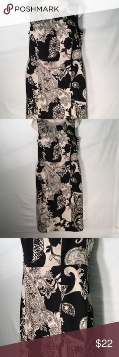 Talbots Sleeveless Dress Size 8 Talbots Sleeveless Dress Size 8. Very classy dress! Fully lined. Pattern is black and off-white. I fell in love with this dress as soon as I saw it! Talbots Dresses