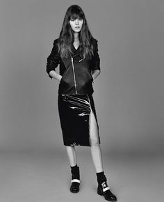 Freja Beha Erichsen wears Jacket, skirt and boots Christopher Kane.