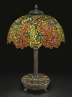 "** Tiffany Studios New York ""Laburnum"" leaded glass and patinated bronze table lamp."