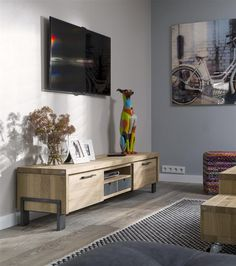 The Modrava tv-sideboard is available in width 180cm (as shown) or 150cm. You can turn the drawer around, so you will get a wooden or grey drawer.