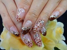 Diagonal French manicure: diagonal french manicure with leopard print and rhinestones
