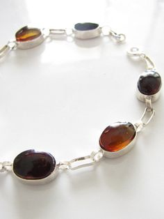 Sterling silver setting with 7 pieces of varying tones of Mexican amber. www.chiapasbazaar.com