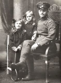 Eva Braun as a child with her father Fritz and older sister Ilsa