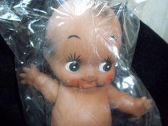 """SOLD   Vintage Black Cupid Kewpie Doll  Original Packaging w Moveable Arms Head Back Wings - never opened  5 l/2""""- Black Americana. $10.00, via Etsy."""