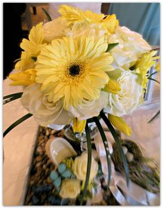 Bridal bouquet created of soft buttery yellow gerbera daisy, paired with sunny yellow tulips and white garden roses.  Designed by 1800Flowers|Flowerama Iowa City