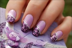 This awesome design has three elements that are diagonal leopard french tips, lavender nailpolish and sparkling rhinestones at the meeting egde of the nail polish and leopard design. So try out these nails and be a matter of talk.