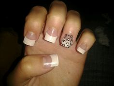 Simple French tip design with leopard print.